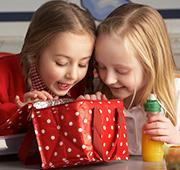 2 little girls opening a present