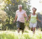 An older couple jogging together
